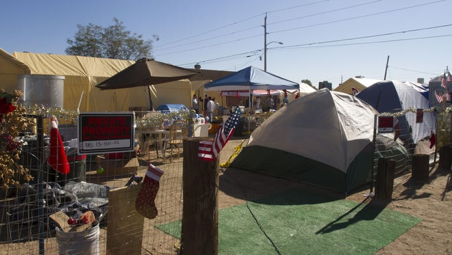 Residents and volunteers help pack up Camp Alpha in Phoenix on Thursday, Dec. 17, 2015. Camp Alpha, which was camping ground for homeless veterans, was ordered to disband by the City of Phoenix.