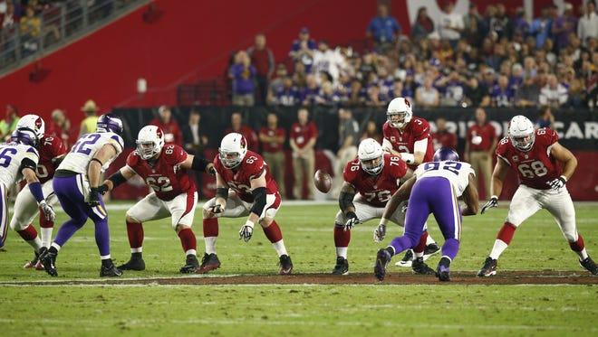 Arizona Cardinals quarterback Carson Palmer, Ted Larsen (62), Lyle Sendlein (63), Mike Iupati (76) and Jared Veldheer (68) against the Minnesota Vikings in the second half on Dec. 10, 2015 in Glendale, Ariz.