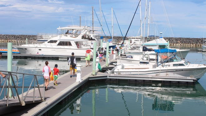 In this August 2014 file photo, tourists use the newly renovated Dock A at the Agat Marina to get to dolphin-watching tours, which launch from the dock.