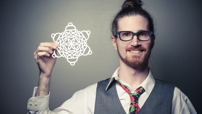 Artist George Meluch holds the hipster santa snow flake he created for readers to make at home, 12/10/2015.