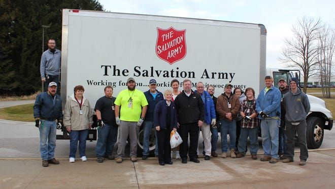 NextEra Point Beach Nuclear Plant team members are seen here with members of the Salvation Army of Manitowoc County in front of a truck filled with holiday gifts donated as part of the station's annual Christmas Star Program. Each year, the station takes wish lists from children and families from the Domestic Violence Center of Manitowoc County, the Salvation Army of Manitowoc County and the Two Rivers Ecumenical Pantry. Point Beach team members then shop for those items. The gifts filled rooms at the Energy Center where they were stored until the agencies came to pick them up. Employees then helped load hundreds of gifts into trucks and vans for transport.