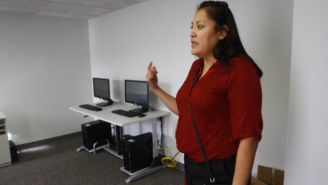 Delilah Goodluck provides a tour Dec. 10 at the new Navajo Nation Department for Self Reliance location in Farmington.
