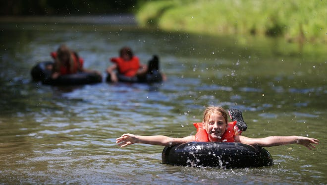 Girl Scouts swim and play in a creek in eastern Iowa in 2015.