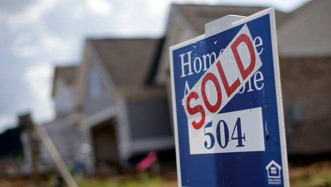 This June 4, 2015, file photo, shows a sign indicating a site has been sold in a new home development in Nashville, Tenn.