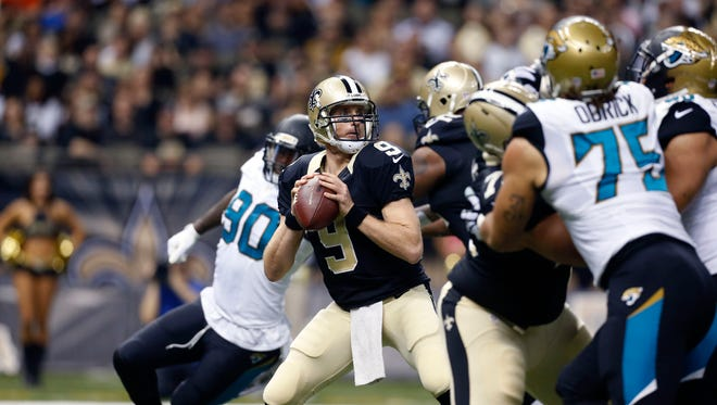 New Orleans Saints quarterback Drew Brees (9) drops back to pass in the first half of an NFL football game against the Jacksonville Jaguars on Sunday in New Orleans.