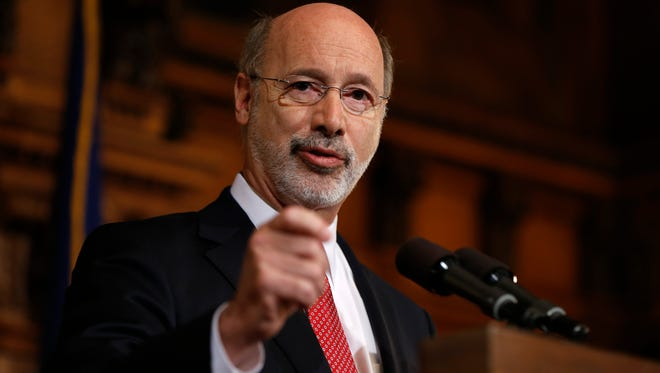 Pennsylvania Gov. Tom Wolf speaks with members of the media Tuesday, Dec. 29, 2015, at the state Capitol in Harrisburg. Wolf said he is rejecting parts of a $30.3 billion state budget plan that's already a record six months overdue, but he's freeing up over $23 billion in emergency funding.