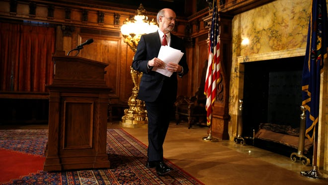 Pennsylvania Gov. Tom Wolf walks from the podium at a news conference Tuesday, Dec. 29, 2015, at the state Capitol.