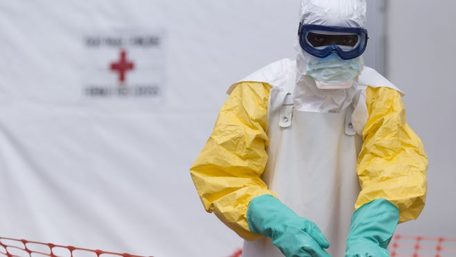 A health worker is seen at the Ebola treatment center run by the French Red Cross in Macenta, Guinea, on Nov. 20, 2014.