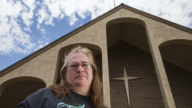 Jenita Moriarty, widow of murdered Phoenix 'Pastor Jack' Moriarty, spreads the pastor's ashes at the Royal Palms Baptist Church in Phoenix. They initially met at the church, so Jenita Moriarty wanted the ashes there in memory of him.