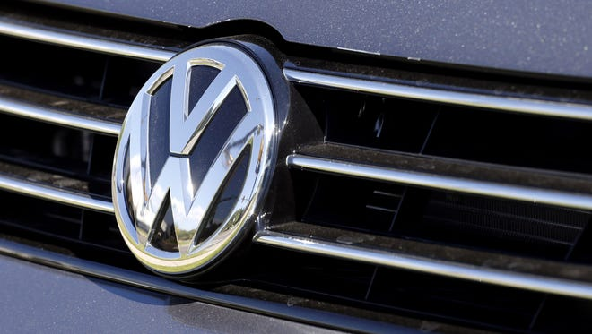 The grille of a Volkswagen car for sale is decorated with the iconic company symbol