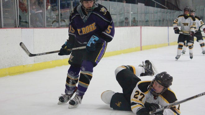 Alex Phipps (15) of St. Rose helped lead the Frozen Roses to a 4-2 win over St. John Vianney on Tuesday.