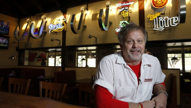 Shawn Shepherd, the co-owner and operating partner of Wahoo Seafood Grill, sits at the bar of the restaurant on Monday, Jan. 4, 2016.
