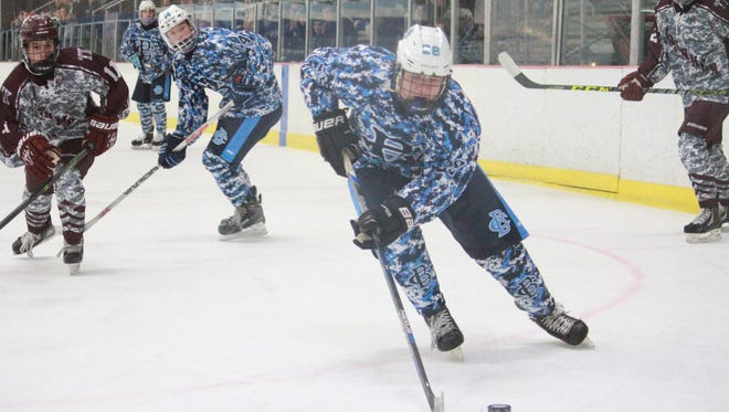 Cristian Winters (20) of CBA cruises through the offensive zone during the Colts' Military Appreciation Night.