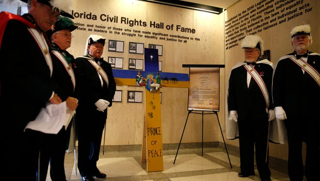 """The Father Hugon Council 3521 of the Knights of Columbus dedicated """"Cross of the Nativity: Prince of Peace"""" to U.S. Cuban relations Wednesday morning in the Florida Capitol Rotunda."""