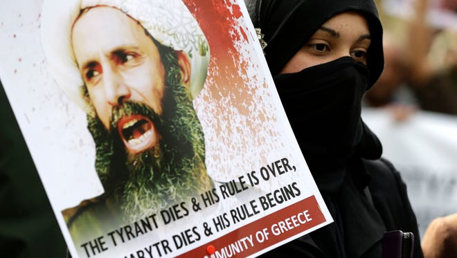A Shia Muslim who lives in Greece takes part in a rally against the execution of cleric Sheikh Nimr al-Nimr outside Saudi Arabia's Embassy in Athens on  Wednesday.