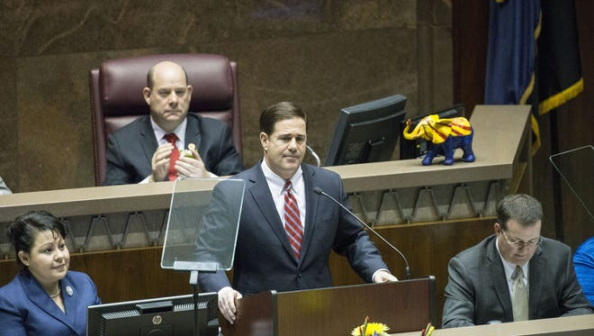 """Gov. Doug Ducey address his State of the State address in the House chambers on Monday Jan 11, 2016.  Ducey began his second State of the State with the usual pleasantries, then launched into a case for his first-year record, taking credit for confronting the projected billion dollar deficit, balancing the budget, and resolving a school-funding lawsuit that """"froze progress for our kids."""""""