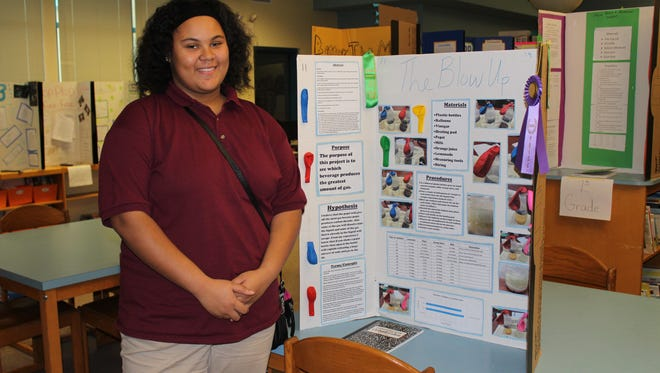"""Aaliyah Collins, an eighth-grader, placed first in the science fair at Quarter Mile Lane School in Bridgeton. For her project, """"The Blow Up,"""" she tested beverages to determine which one produced the greatest amount of gas."""