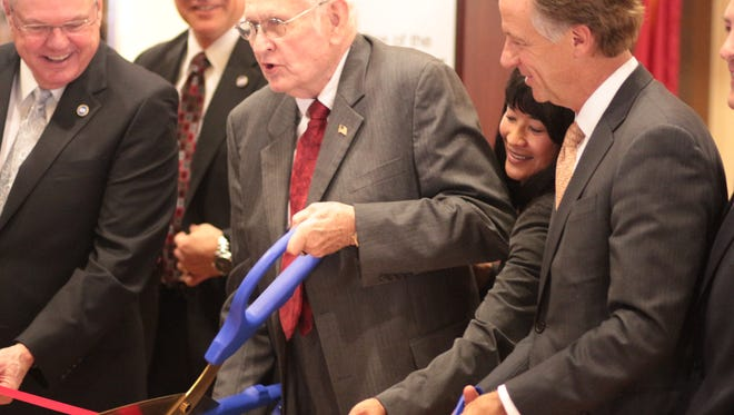 Wendell Gilbert, middle, Department of Veterans Services Commissioner Many-Bears Grinder, second from right, and Gov. Bill Haslam help cut the ribbon at Monday's unveiling of the Brig. Gen. Wendell H. Gilbert Tennessee State Veterans Home in Clarksville.