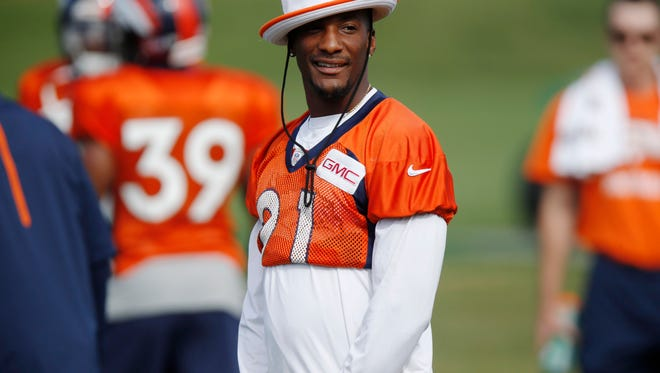 In this Wednesday, Aug. 19, 2015, photograph, Denver Broncos cornerback Aqib Talib looks on during drills at the team's NFL football training camp session in Englewood, Colo. The Broncos are preparing to host the Pittsburgh Steelers in a second-round AFC playoff game Sunday, Jan. 17, 2016, in Denver. (AP Photo/David Zalubowski)