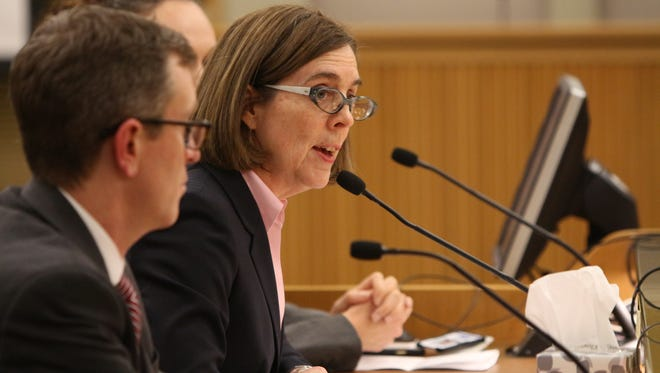 Gov. Kate Brown testifies on Jan. 14 to a join committee examining plans to raise the minimum wage.