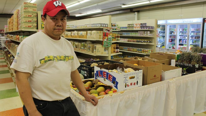 Chong Xiong stands in the newly opened C & B Super Market at 640 S. Third Ave., Wausau. He manages the store and his wife, Bai Vue, is the owner.