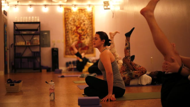 Journey's in Yoga Instructor Rachel Spells leads a beginner's class, entitled Intro Flow, on Thursday evening at their Tallahassee studio.