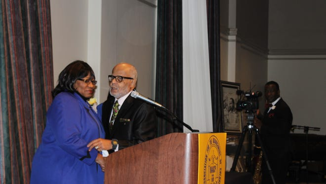 The Rev. Richard Sibert hugs NAACP Third Vice President Mary Wade, when she presented him the Jerry Anderson Humanitarian Award. WKRN's Larry Flowers, right, did double duty as news reporter and the event's emcee.