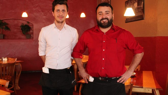 From left, Gino Elezi and Giovanni's Italian Restaurant co-owner Massimo Elezi.