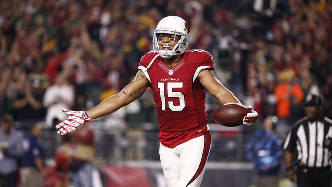 Arizona Cardinals wide receiver Michael Floyd celebrates after his second touchdown catch against Green Bay Packers during the NFC Divisional Playoffs on Jan. 16, 2016 in Glendale, Ariz.