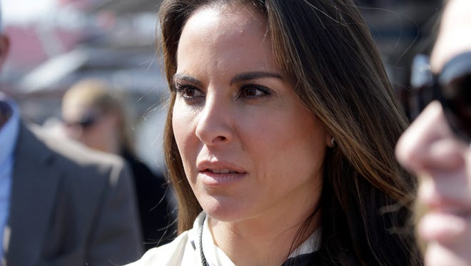 """FILE - In this March 24, 2013 file photo, Mexican actress Kate Del Castillo attends a NASCAR Sprint Cup auto race in Fontana, Calif. Mexican authorities said on Monday, Jan. 18, 2016, that they want to talk to the Mexican actress who arranged an interview with drug lord Joaquin """"El Chapo"""" Guzman for actor Sean Penn. (AP Photo/Reed Saxon, File)"""