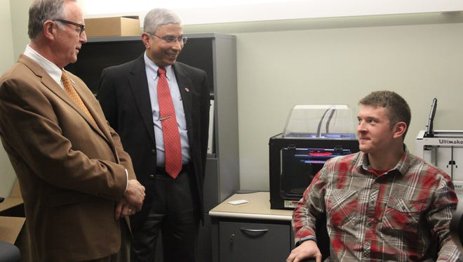 USD leaders Jim Abbott and Venky Venkatachal tour the school's new innovation lab, which includes 3D printing.