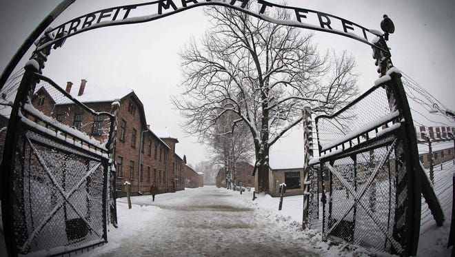 The entrance to the former Nazi concentration camp Auschwitz-Birkenau with the lettering 'Arbeit macht frei' ('Work makes you free'). A 95-year-old former medic at the Auschwitz death camp will go on trial next month on at least 3,681 counts of accessory to murder, German authorities said on January 18, 2016.