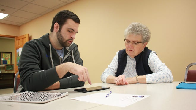 At a recent help session at the Fond du Lac Senior Center, Mitch Sheer, president of the Moraine Park Technical College IT Club, helps Janet Vermeer with her tablet.