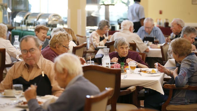 Residents of Allegro's senior living facility sit down in the dining hall for lunch on Friday, Jan. 15, 2015.