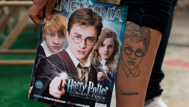 "In this Sept. 29, 2015 photo, a Harry Potter fan shows off her tattoo during the inauguration of ""La Casa de Asher Potter,"" a museum housing Asher Silva Vargas' Guinness World Record-holding collection of Harry Potter memorabilia in Mexico City."