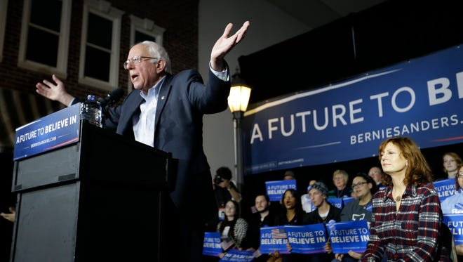 Bernie Sanders speaks during a campaign event as actress Susan Sarandon looks on at Music Man Square on Jan. 27, 2016, in Mason City, Iowa.