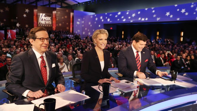 Debate moderators Chris Wallace, Megyn Kelly and Bret Baier on set during the Republican debate on Jan. 28, 2016, in Des Moines.