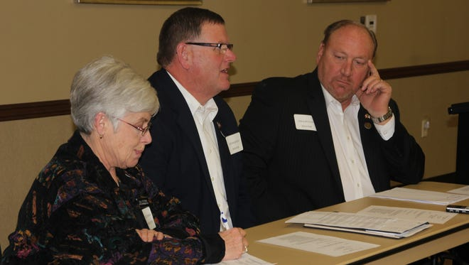 Sen. Kevin Kinney (D-Oxford) comments on education and the school state aid process as Rep. Sally Stutsman (D-Riverside, left) and Tim Kapucian (R-Keystone) listen.