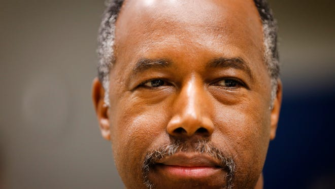 Republican presidential candidate, Ben Carson waits to speak during a caucus at Des Moines Christian School Monday, Feb. 1, 2016.
