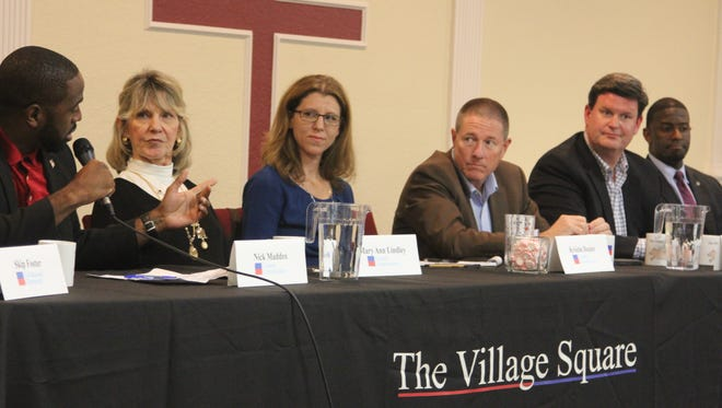 Leon County Commissioner Nick Maddox answers a question at Monday's night's town hall meeting hosted by the Village Square while fellow county Commissioners Mary Ann Lindley, Kristin Dozier, Brian Desloge, John Dailey and Mayor Andrew Gillum look on.