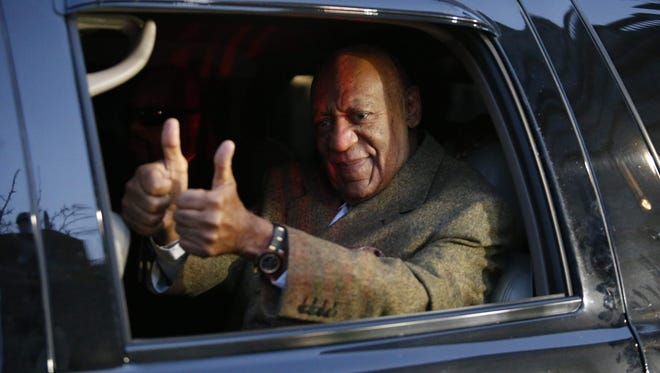 Bill Cosby gives double thumbs up as he leaves the Montgomery County courthouse in Norristown, Pa. after hearing on Feb. 2 , 2016.