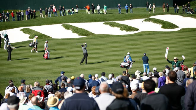 Phil Mickelson hits his second shot on the 18th hole during the first round of the Waste Management Phoenix Open golf tournament at TPC Scottsdale on Thursday, February 4, 2016.