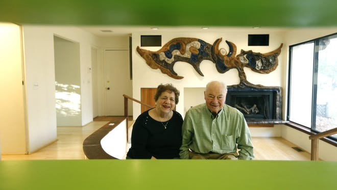 Seen here through kitchen cabinets, famed architect James H. Johnson and his wife Sarah in the Penfield he designed for them.