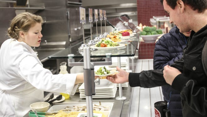 Chef Irina Bakun serves a student the Lamb Salad at Goudy Commons on Small Plates Thursday.