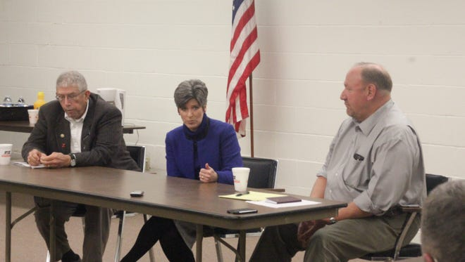 U.S. Sen. Joni Ernst (center) joins state Rep. David Maxwell (left, R-Gibson) and Sen. Tim Kapucian (R-Keystone) for a legislative round table Saturday, Feb. 6, at the Iowa County Farm Bureau office in Williamsburg.