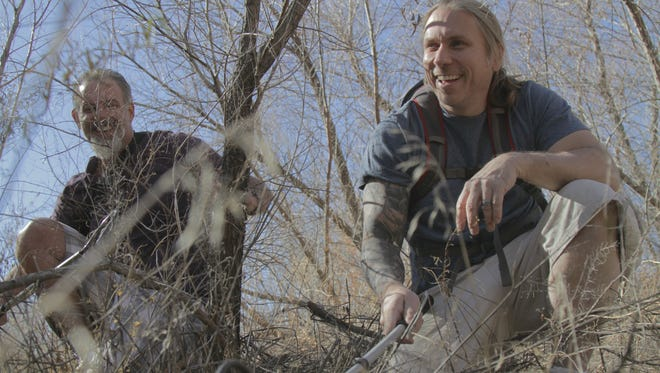 """John Lovchuk, 47, of Croswell, and Brian Barczyk, 45, of Shelby Township, will be featured on """"Venom Hunters"""" on the Discovery Channel at 10 p.m. Feb. 17."""