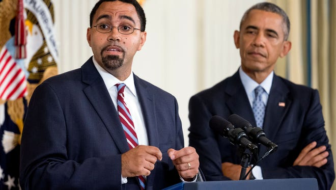In this Oct. 2, 2015 file photo, John King Jr., accompanied by President Barack Obama, speaks in the State Dining Room of the White House in Washington. President Barack Obama will nominate King, now the acting Education Secretary, to serve as Education Secretary after receiving commitments from lawmakers to give his nomination speedy consideration, the White House said Thursday, Feb. 11, 2016. (AP Photo/Andrew Harnik)