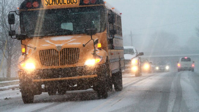 A school bus drives on Lea Boulevard in Edgemoor on Jan. 6, 2015. Twenty states make the records of disciplinary actions taken against teachers available online, but not Delaware.
