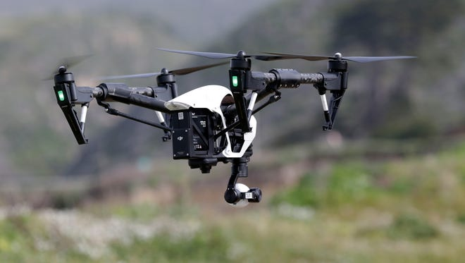 A new report says lawmakers should limit the operation of drones around such areas as correctional facilities, tourist destinations and prominent bridges.