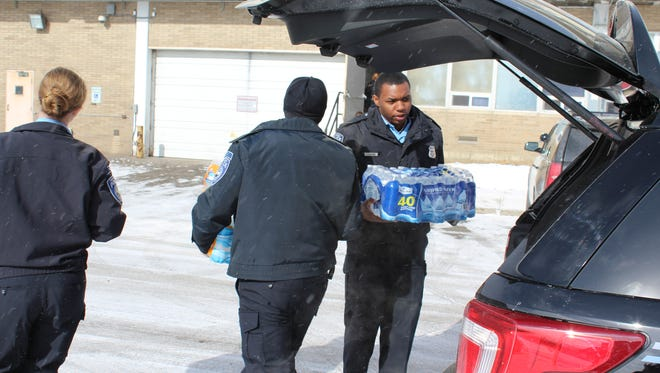 Port Huron police cadets deliver water Saturday, Feb. 13, 2016, to the Flint Police Department.